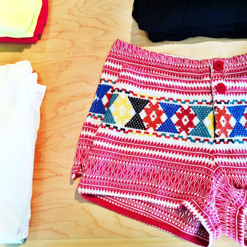 Raquel Greer Gordian exhibits a selection of printed boho-chic shorts.