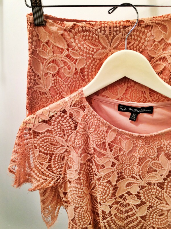 Raquel Greer Gordian displays a lacy, salmon pink matching set by For Love and Lemons from Southern Hippie.