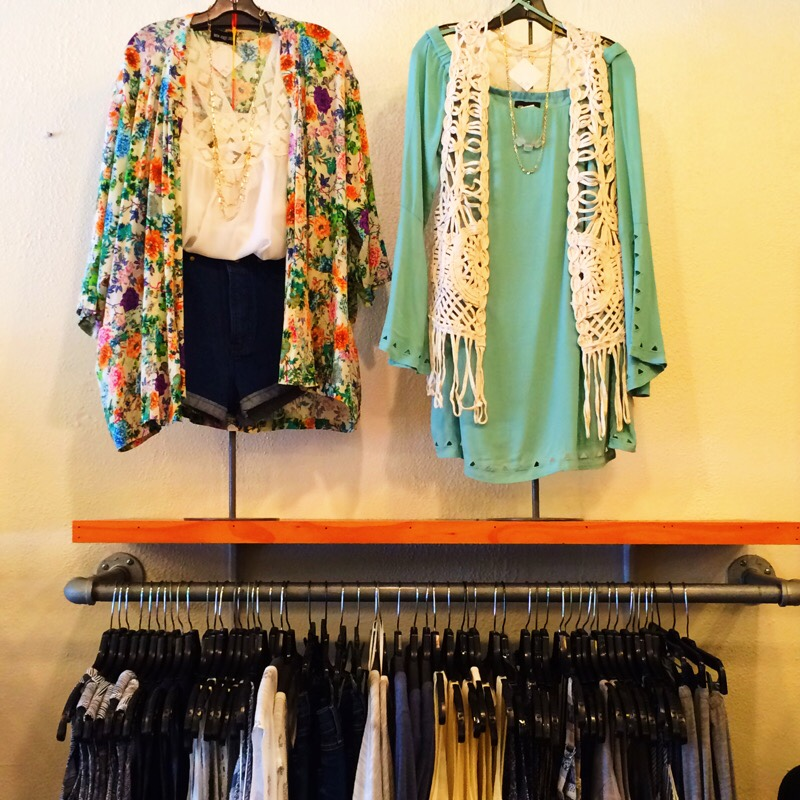 Raquel Greer Gordian displays a selection of tops and colorful kimonos from Strut.