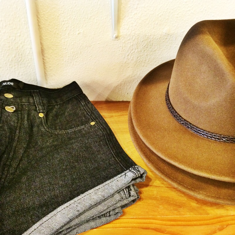 Raquel Greer Gordian displays a cuffed denim short and Western-style hat from Strut.