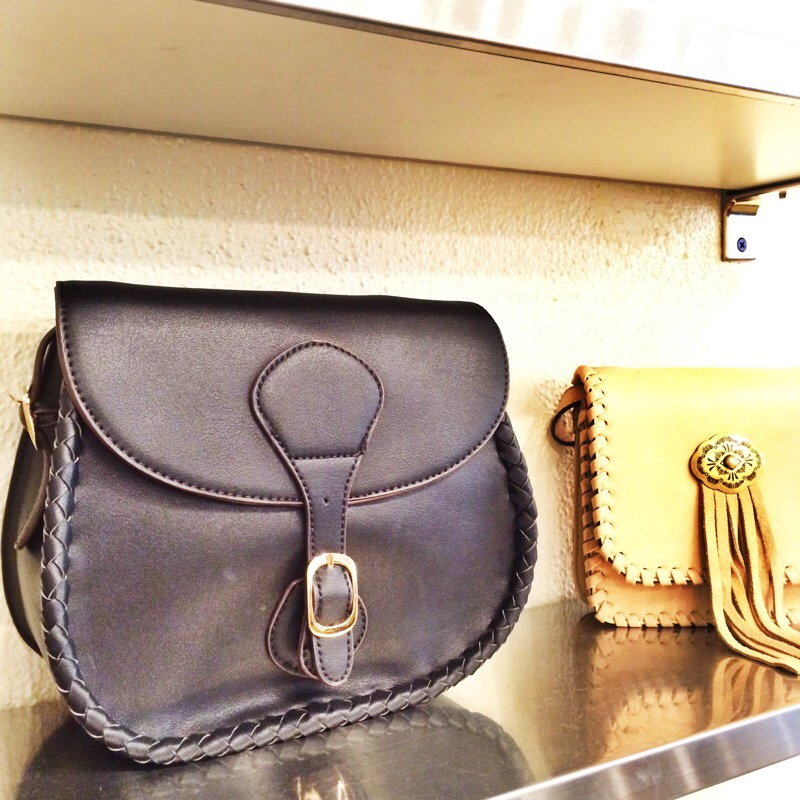 Raquel Greer Gordian displays a selection of leather bags from Strut.