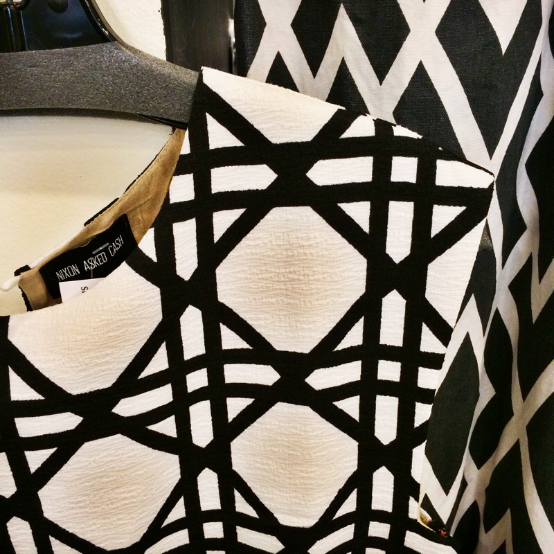 Raquel Greer Gordian exhibits a black and white patterned blouse from the Austin boutique Strut.