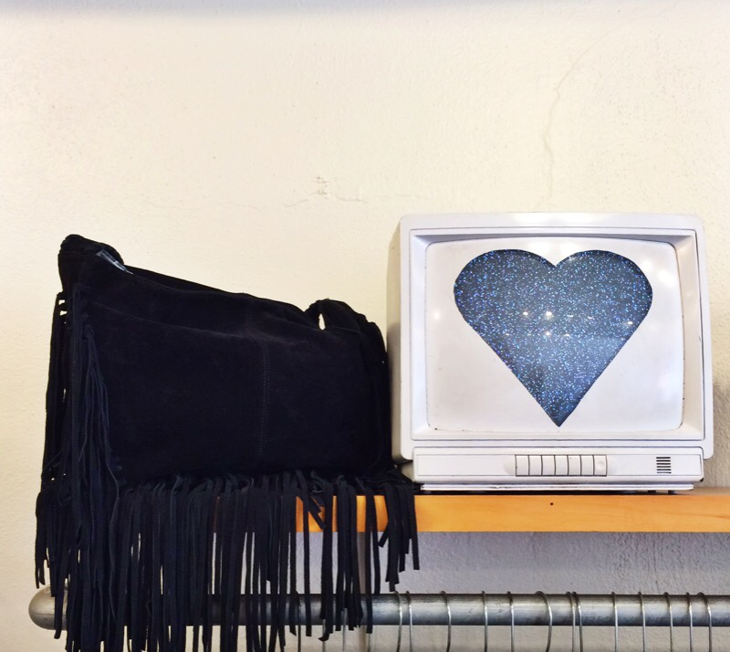 Raquel Greer Gordian shows a picture of a boho, black fringed bag from the local Austin boutique Strut.