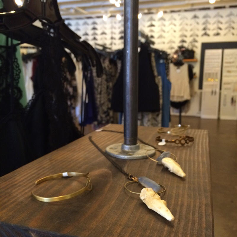 Raquel Greer Gordian exhibits a selection of gold jewelry from the local Austin boutique Strut.