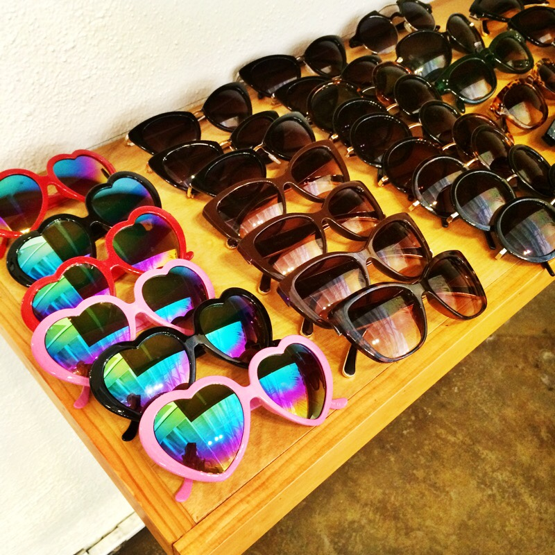 Raquel Greer Gordian displays a wide variety of sunglasses from the local Austin boutique Strut.