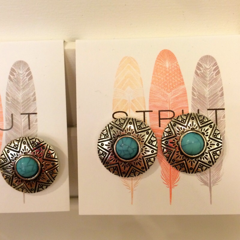 Raquel Greer Gordian displays a pair of boho studs from the boutique Strut.