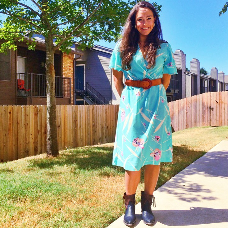 Raquel Greer Gordian pairs a vintage summer dress with Frye boots, geometric earrings, and an Anthropologie belt to add a modern touch.