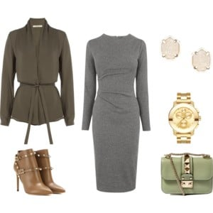 Raquel Greer Gordian exhibits an outfit that pairs the long sleeve gray dress with an army green cardigan, studded booties, gold jewelry, and a green handbag.
