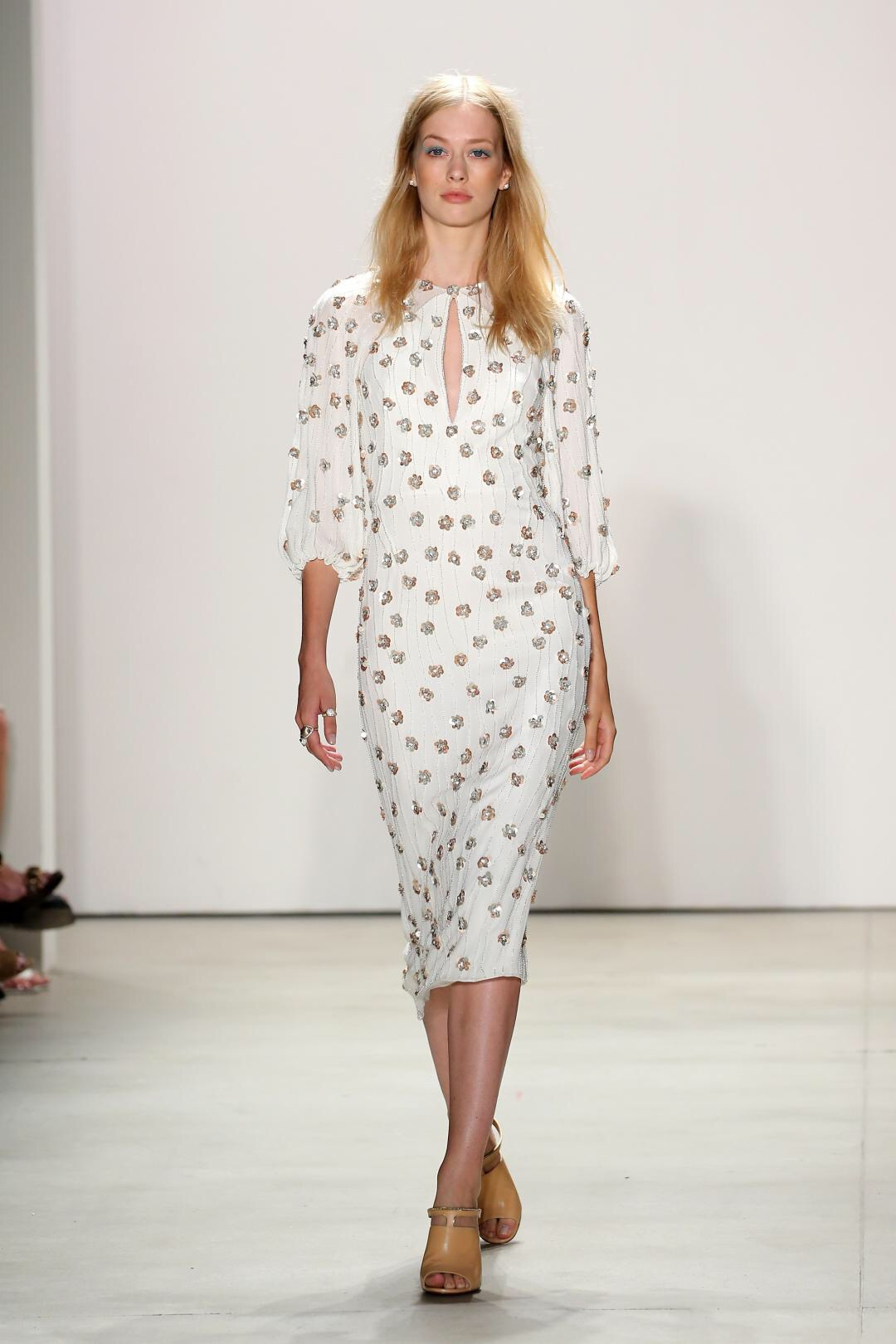 Emily Blanco displays a NYFW Jenny Packam embellished dress.