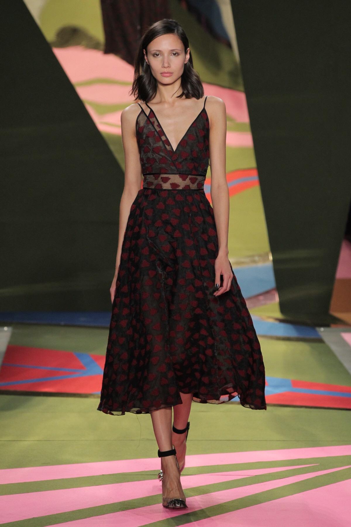 Emily Blanco displays a Lela Rose midi dress from NYFW.