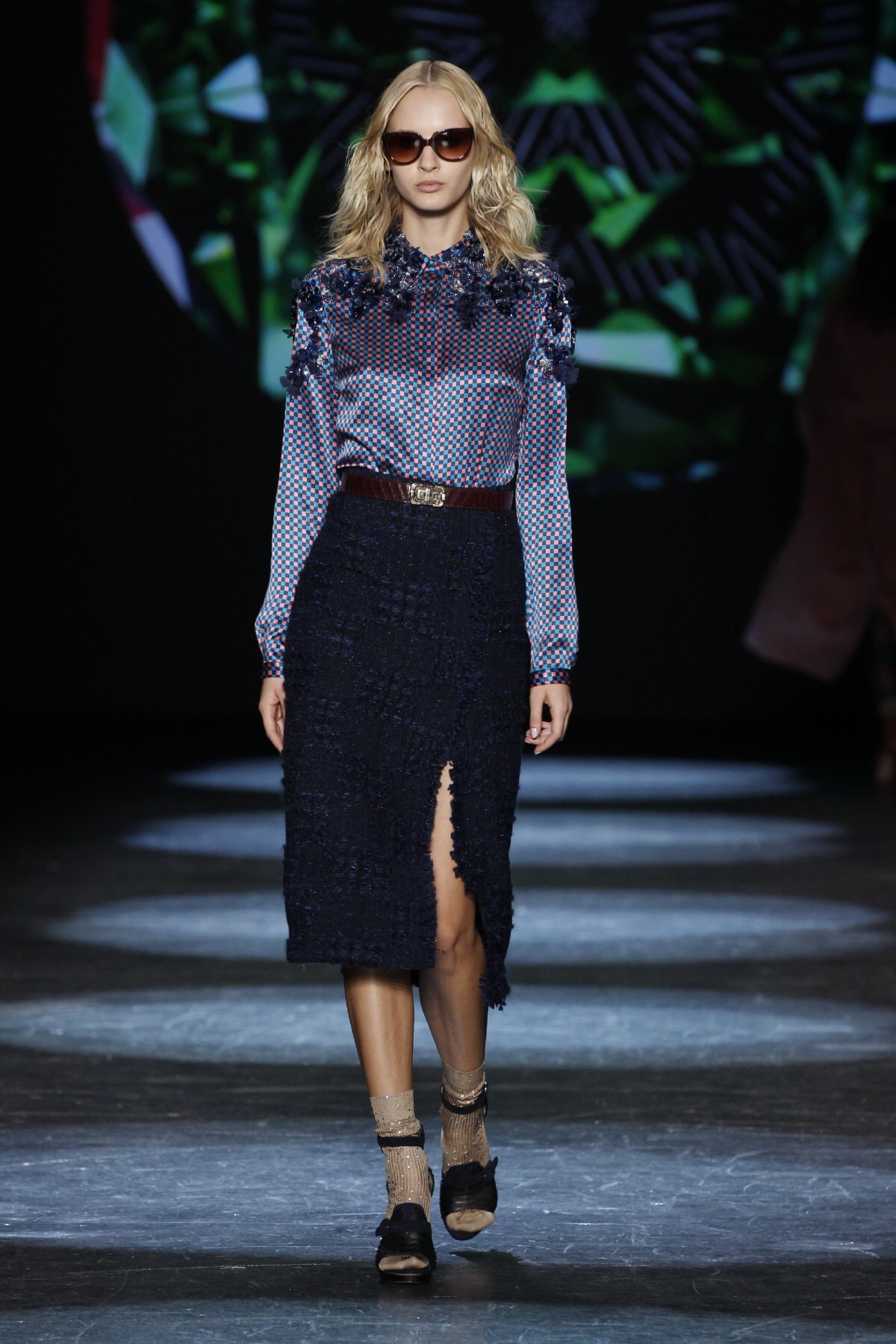 Emily Blanco shows an image of a checkered blouse and midi skirt from Monique Lhullier's NYFW show.