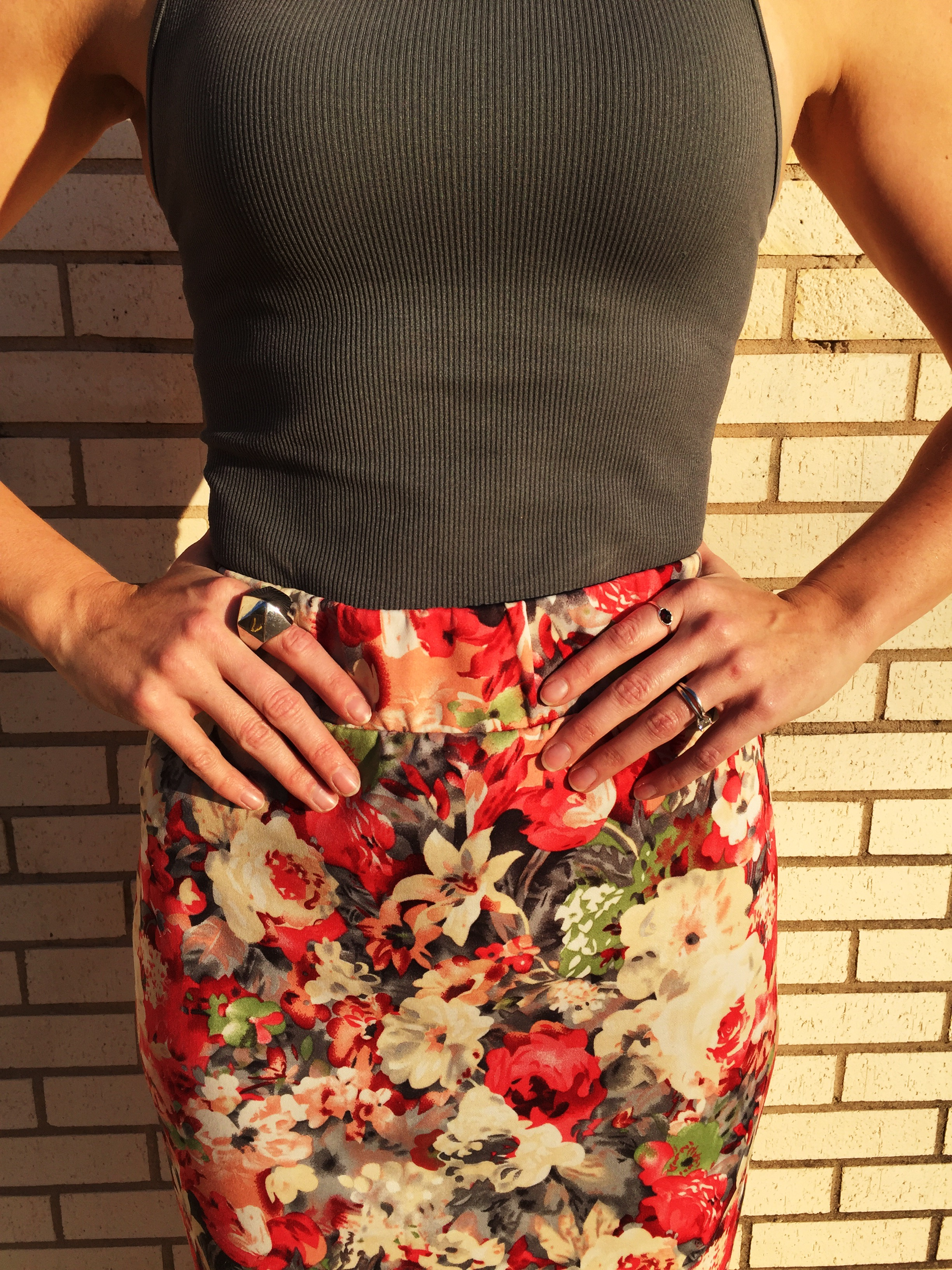 Emily Blanco models a look starring a floral pencil skirt.