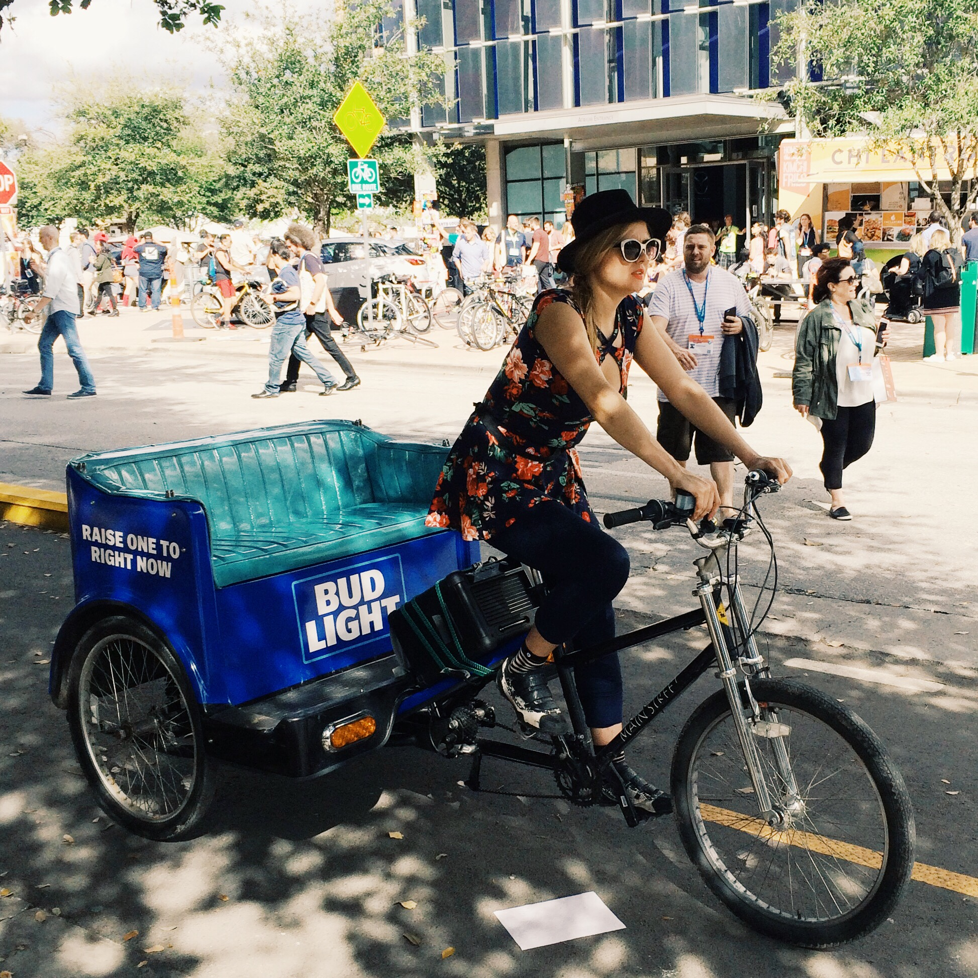 Raquel Greer Gordian captures an image of a driver's SXSW style, even while cycling.