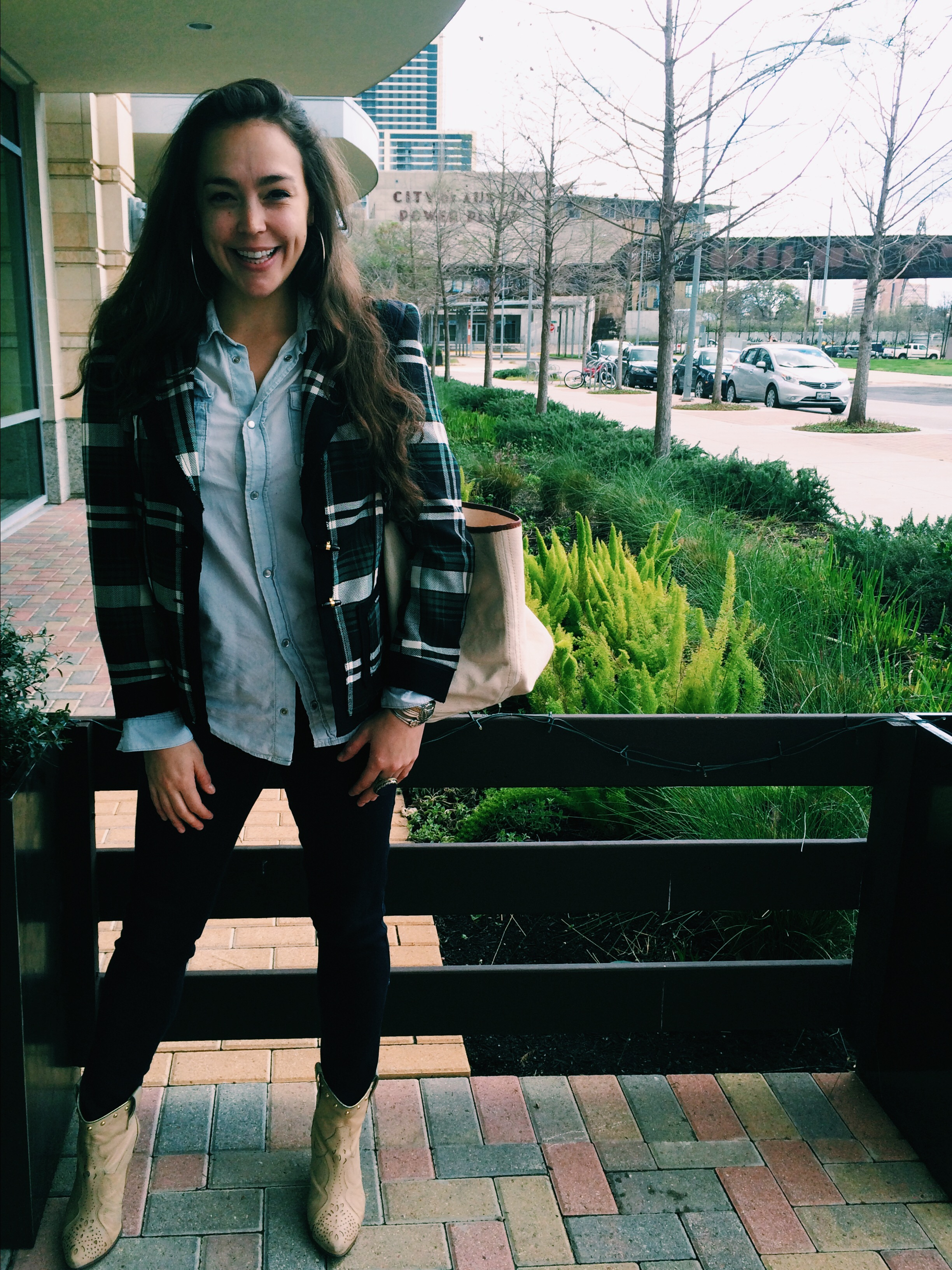 Raquel Greer Gordian models a plaid blazer, chambray button-up, jeans, hoops, and some studded tan booties for SXSW.