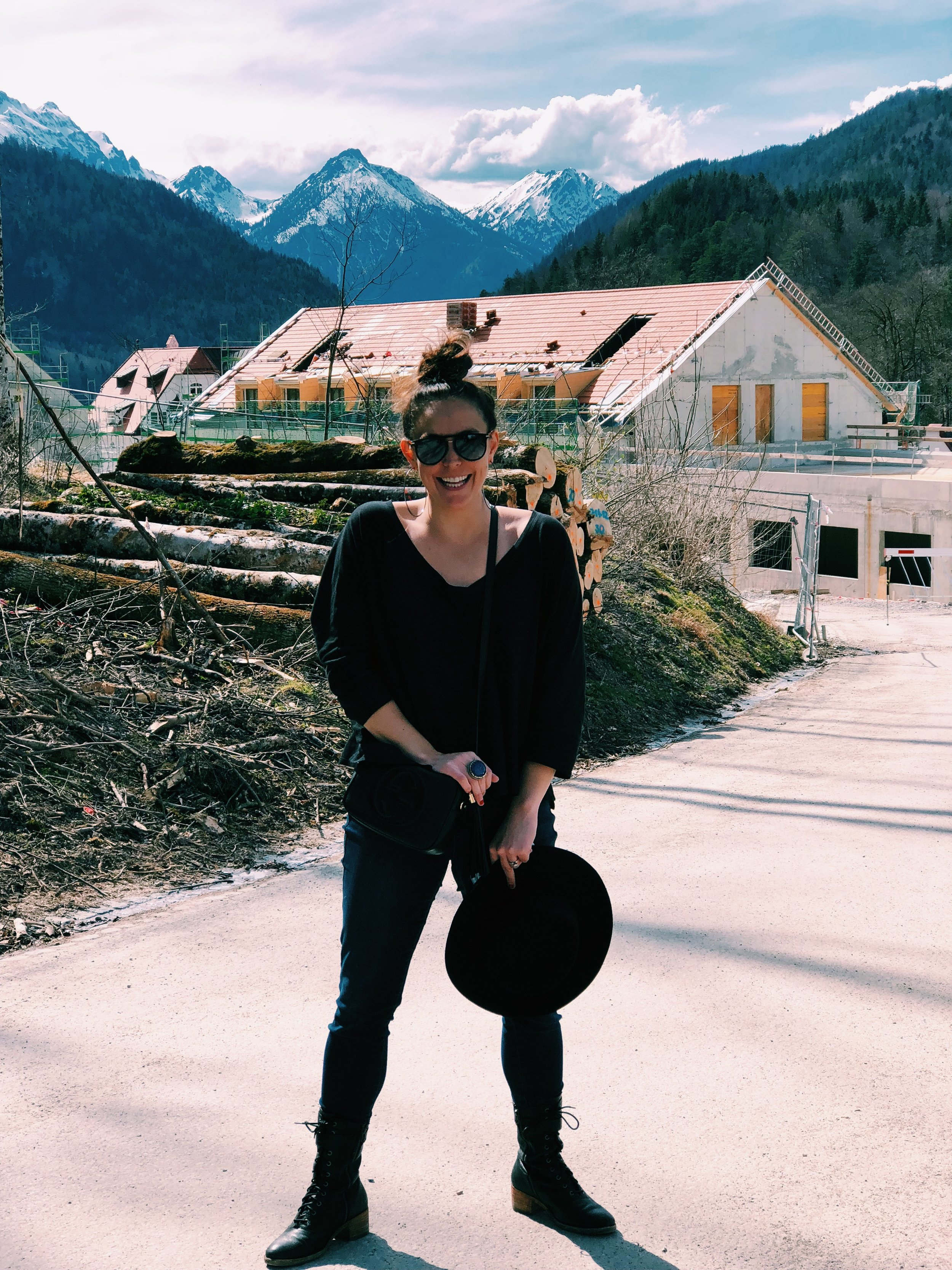 Bavaria, Germany: Wearing my basic black top, black boots and jeans to see Neuschwanstein Castle. To make the neutrals more exciting, I paired my favorite silver hoops and wide-brimmed black hat.