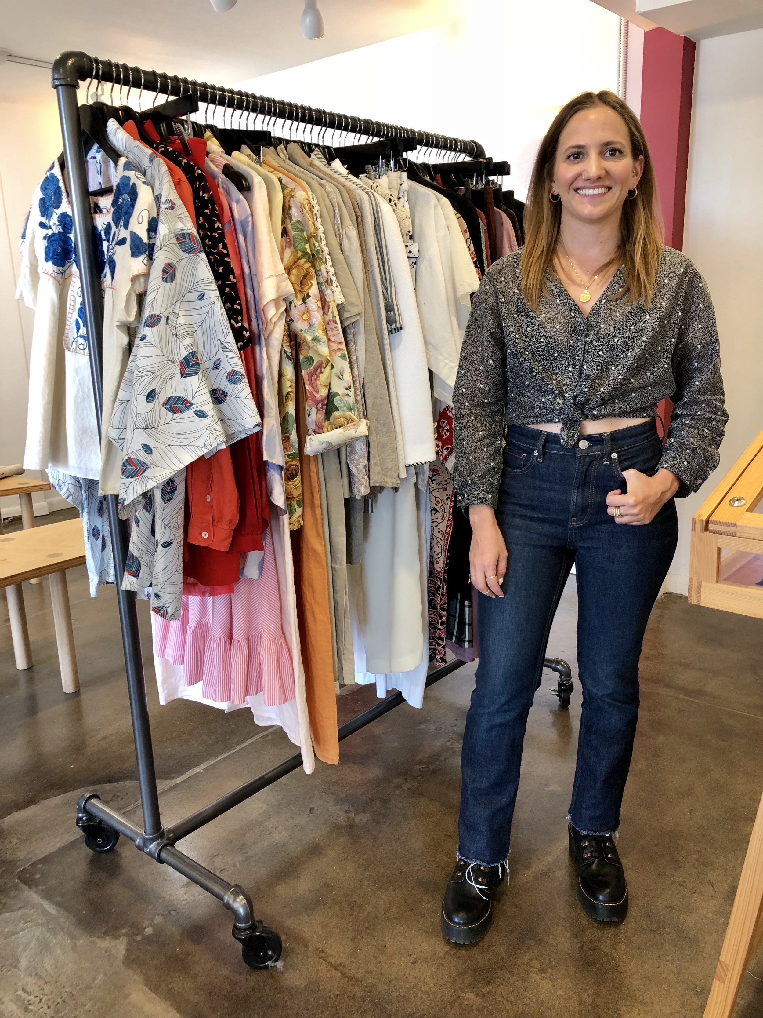 April Onebane with the collection of clothing she has curated for her business, Pieceology Vintage
