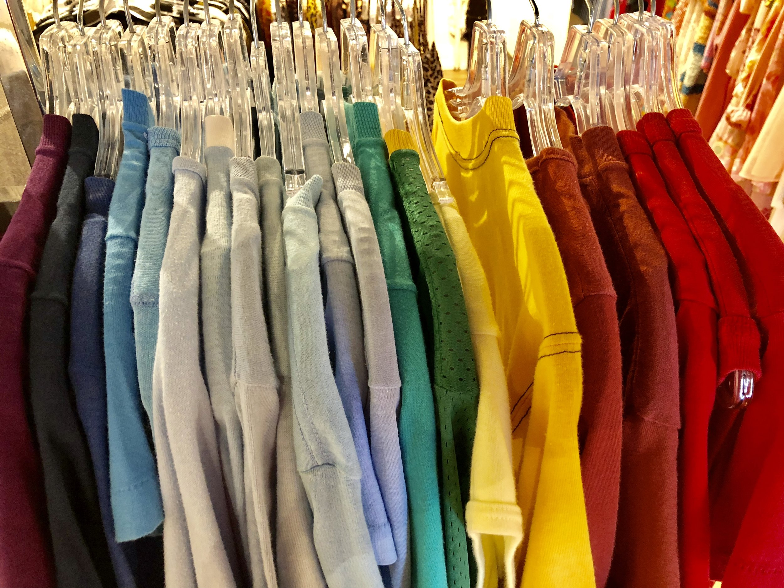 A colorful rack of t-shirts at Austin local shop, Prototype Vintage