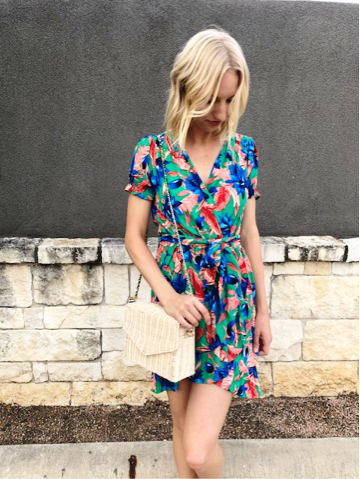 Bailey adds a wrap dress and heels to complete her date night summer look.