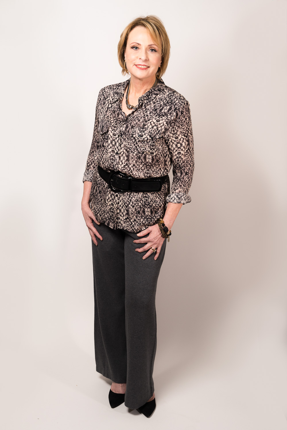 Lori Steiner is styled by Raquel Greer Gordian for a professional occasion in downtown Austin.