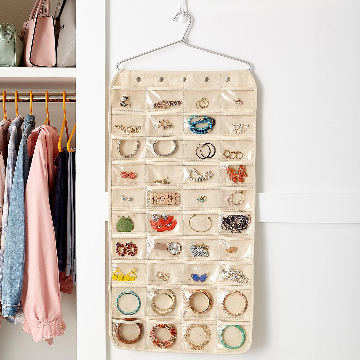 This is the jewelry organizer I have! I love it, because I'm able to see everything easily. I also don't have a ton of space in my closet, and this is an easy, space-saving organizer that fits right in next to your clothes.