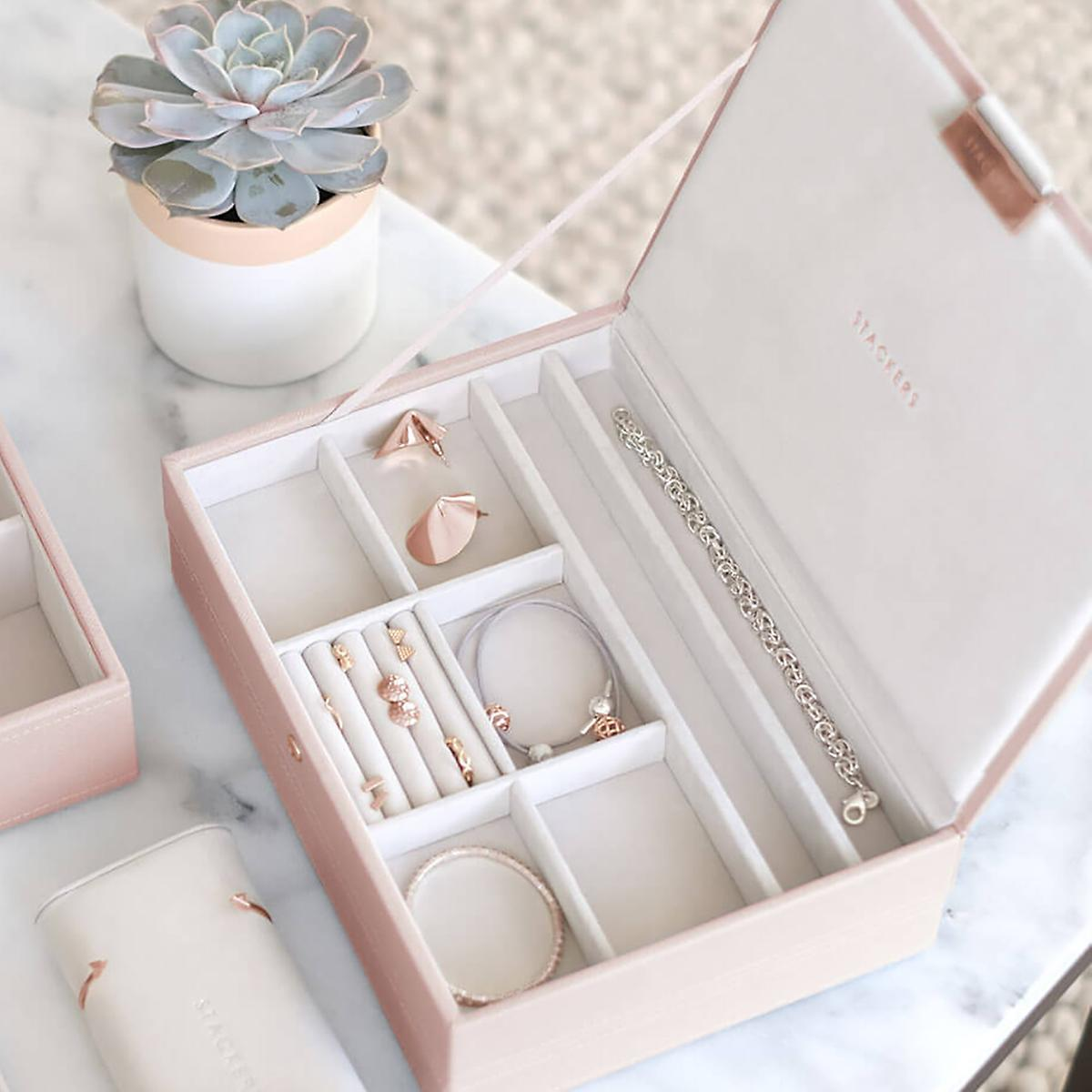 Who doesn't love a classic jewelry box? And this one is the perfect blush to add a romantic touch to your bathroom, bedroom, or closet. Fill in with all your bracelets, rings, and earrings to open a box full of fun jewelry every morning.