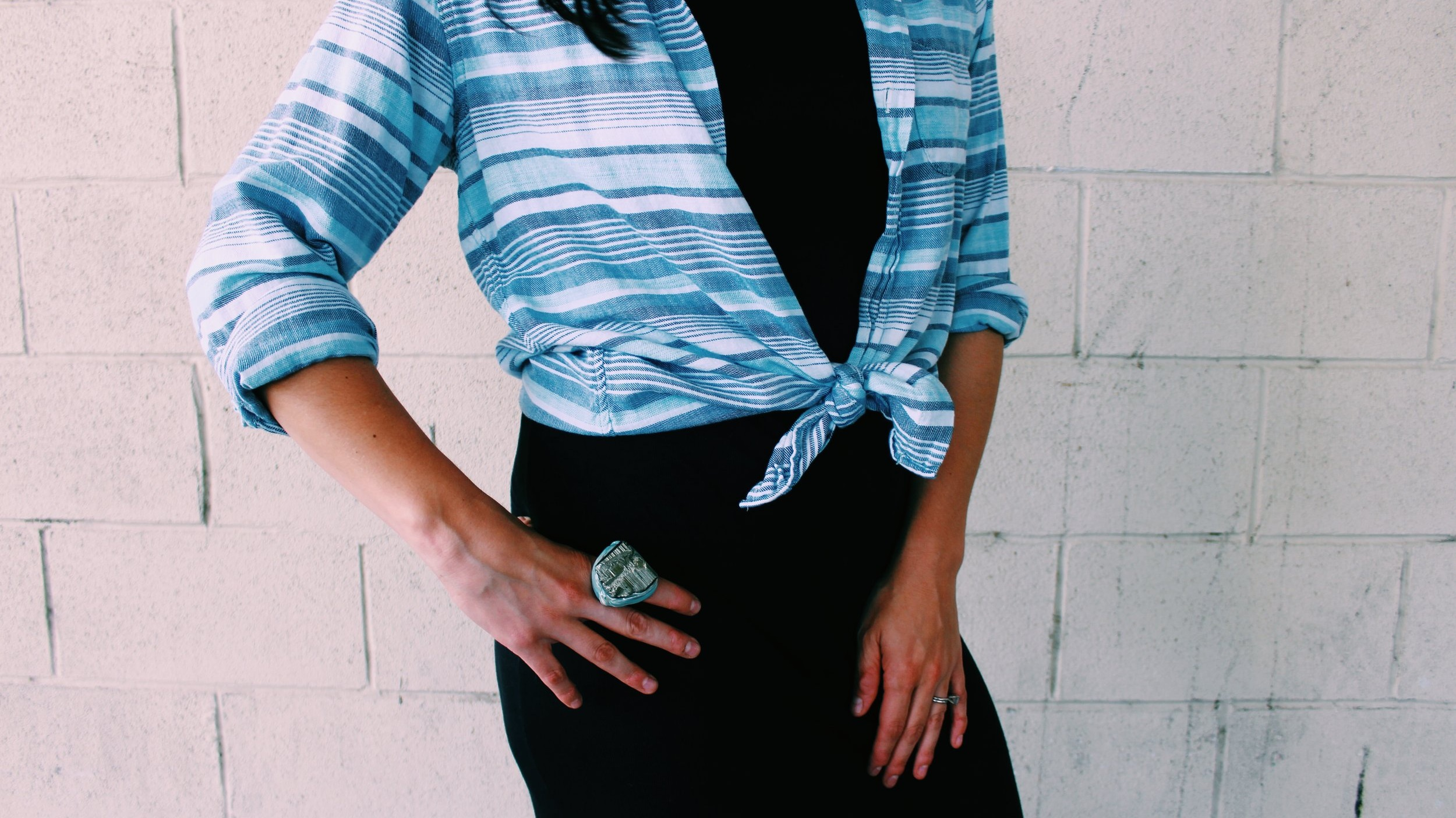 Give your outfit a feminine touch by tying up your favorite button down over top.