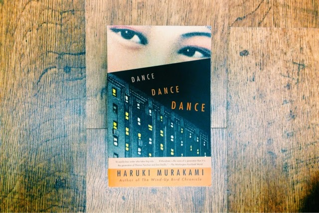 Dance Dance Dance by Murakami. This cover design by John Gall sold me—though I realized after buying it, that it's the fourth of a series.