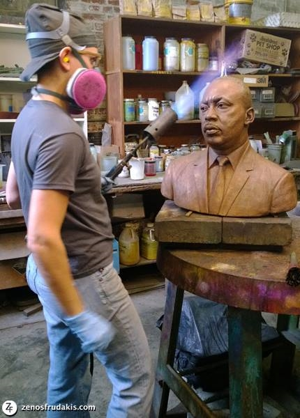 Martin Luther King sculpture at Laran Bronze Foundry. Melanie Serkes develops the patina of the Frudakis sculpture.