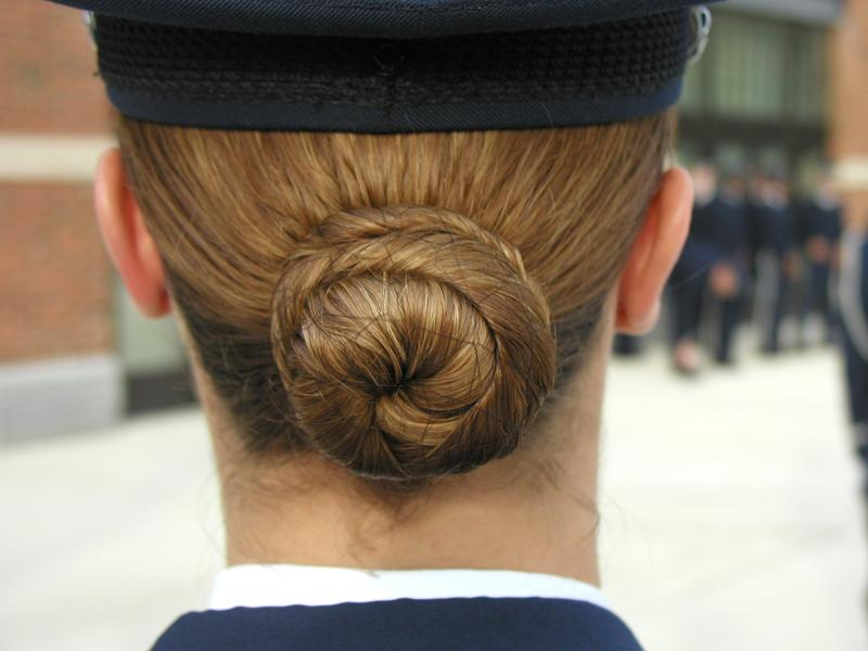 In the case of the female Honor Guard, he recorded her hairstyle.