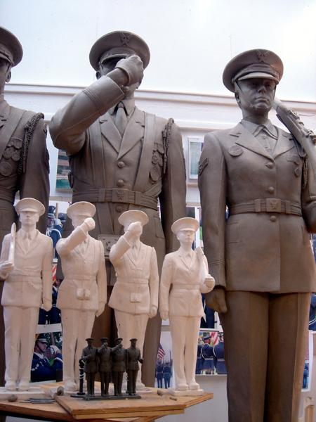 While acknowledging that the vital role of the Honor Guard's precision and formality is integral to the ceremonies in which they engage, Zenos felt strongly that the sculpture needed to convey the breathing presences of the real men and women who comprise this special unit. The challenge was to infuse life into figures that were, by necessity, stationary.