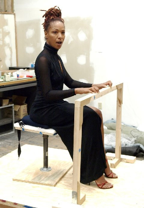 Lisa, Nina Simone's daughter, posing in one of her mother's performance dresses.