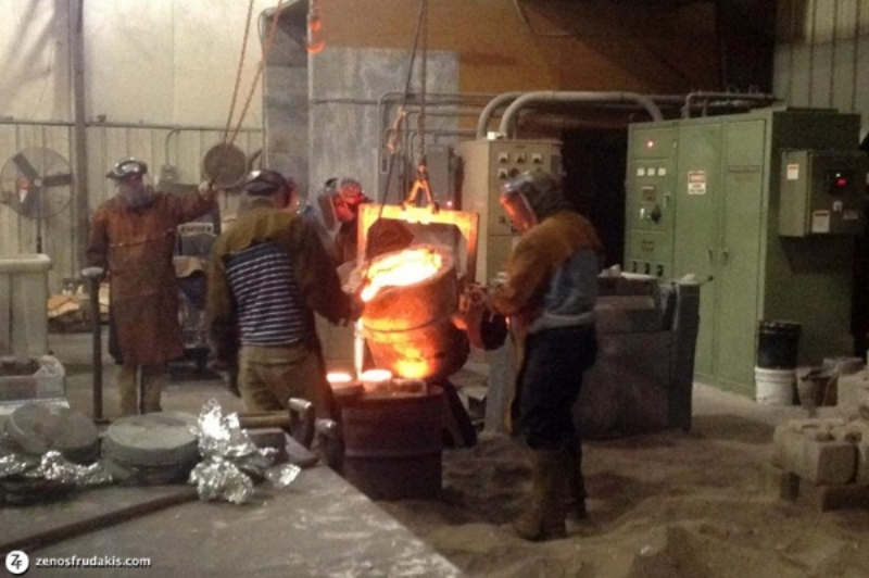 At Laran Bronze Foundry, pouring bronze from the Inductotherm 1,000 lb. furnace.