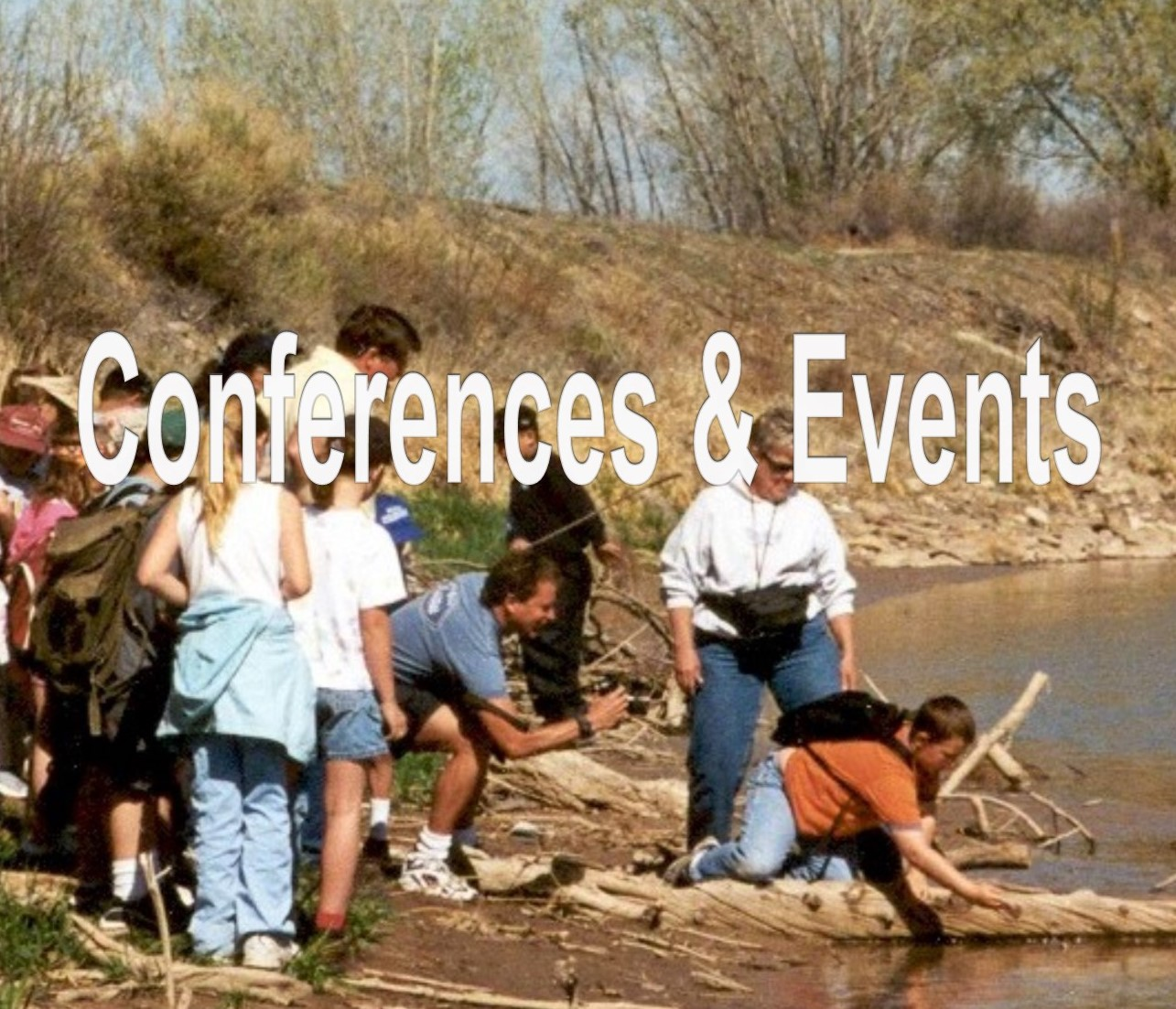Kids who raised razorback sucker. These students in a Western Slope school raised endangered razorback suckers. Here they are releasing them into the Colorado River. Division of Wildlife, 2004