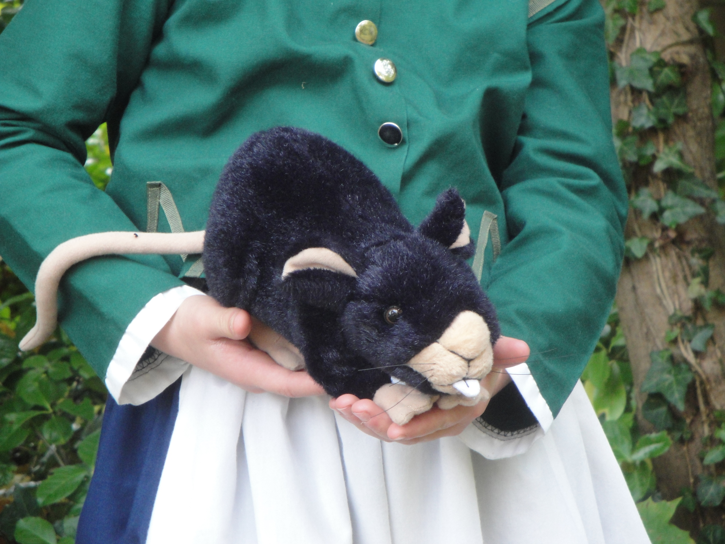 """""""Remember"""" holding a life-sized stuffed version of a ship rat from the 1600s. Eww!"""