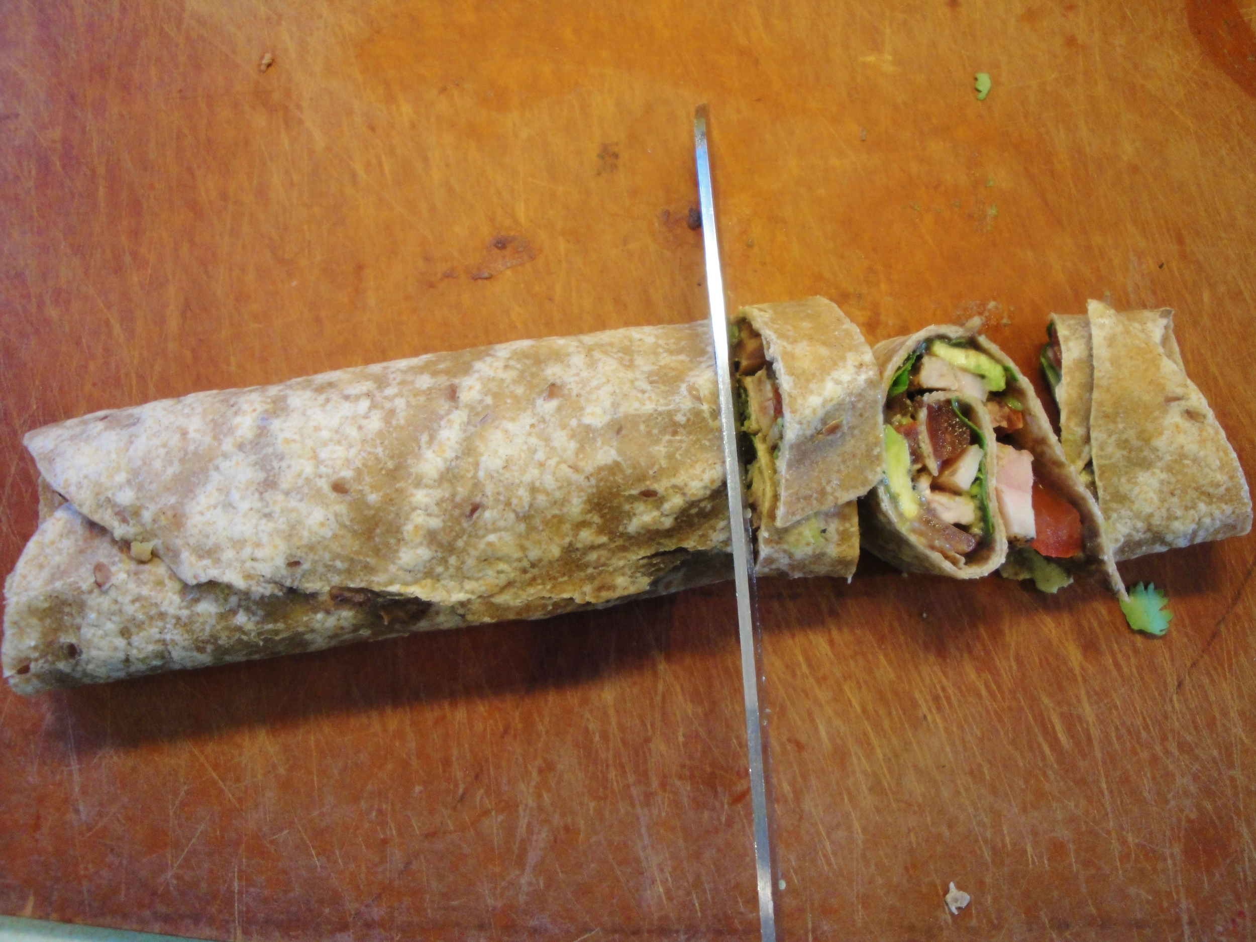 Slicing  Mexican Pinwheels  with a serrated knife