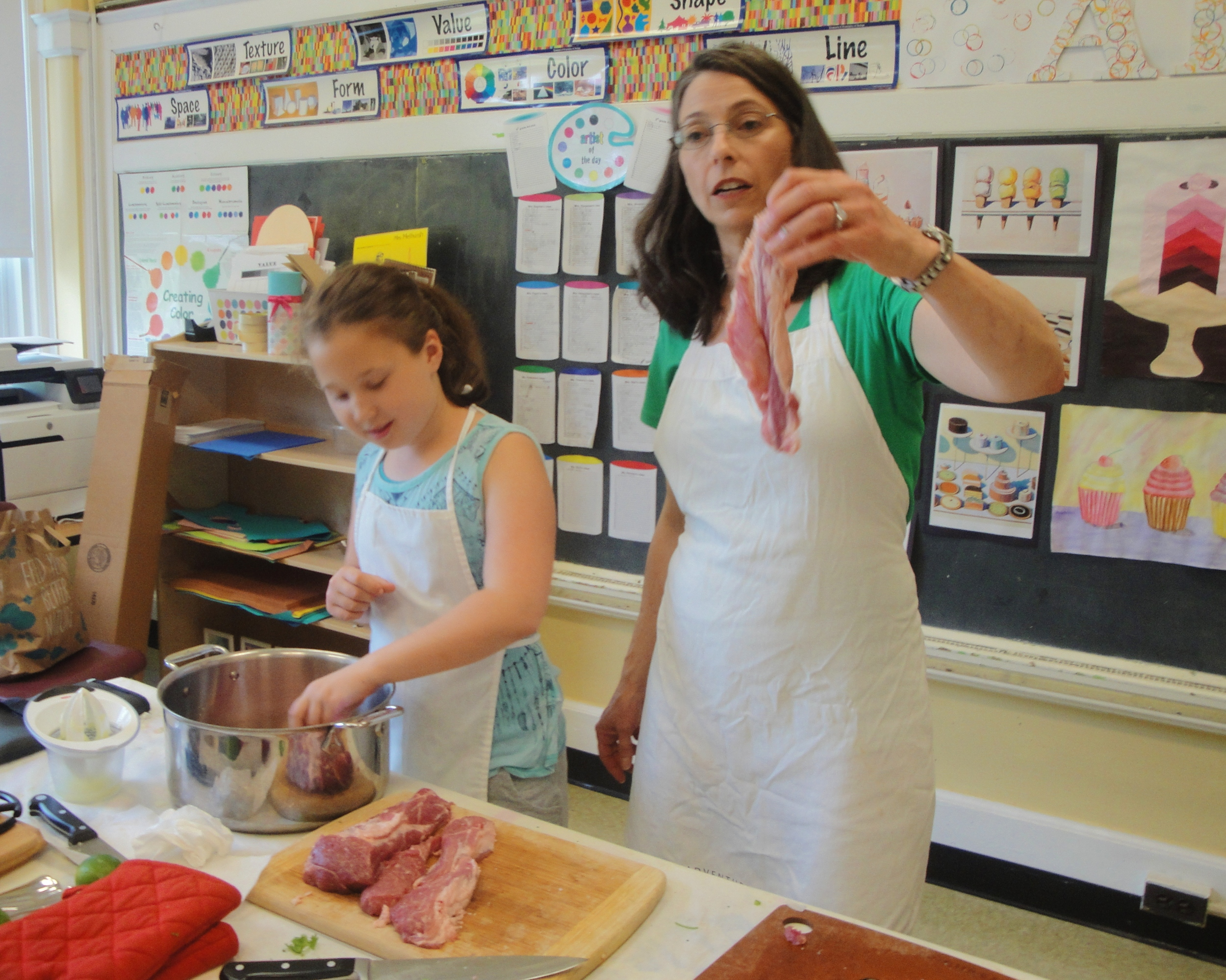 Ms. Lynley points out the fat on pork shoulder - all that fat adds flavor to the finished dish.