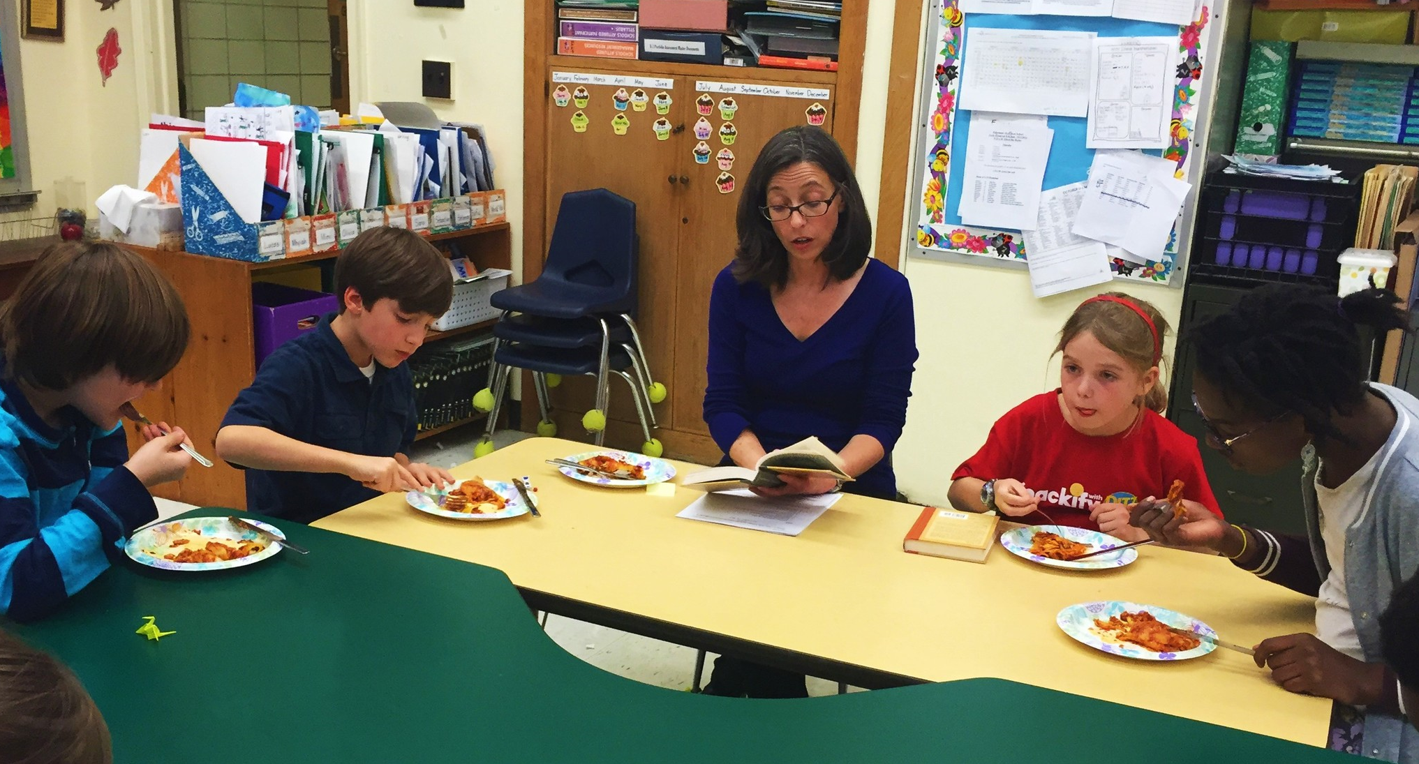 Eating  Chicken Enchiladas  while Ms. Lynley reads from Book 7: The Vile Village.