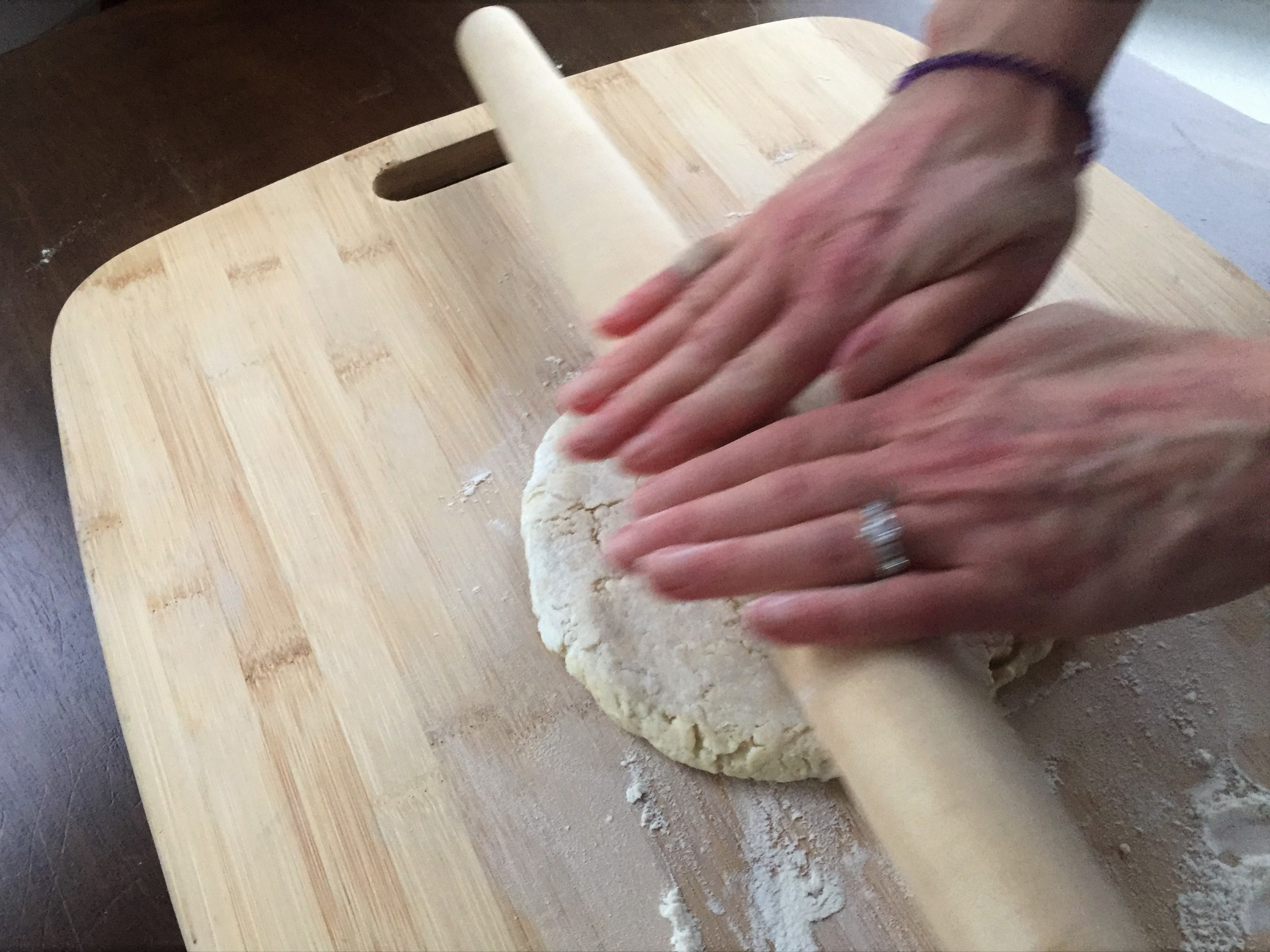 rolling out pie crust pastry