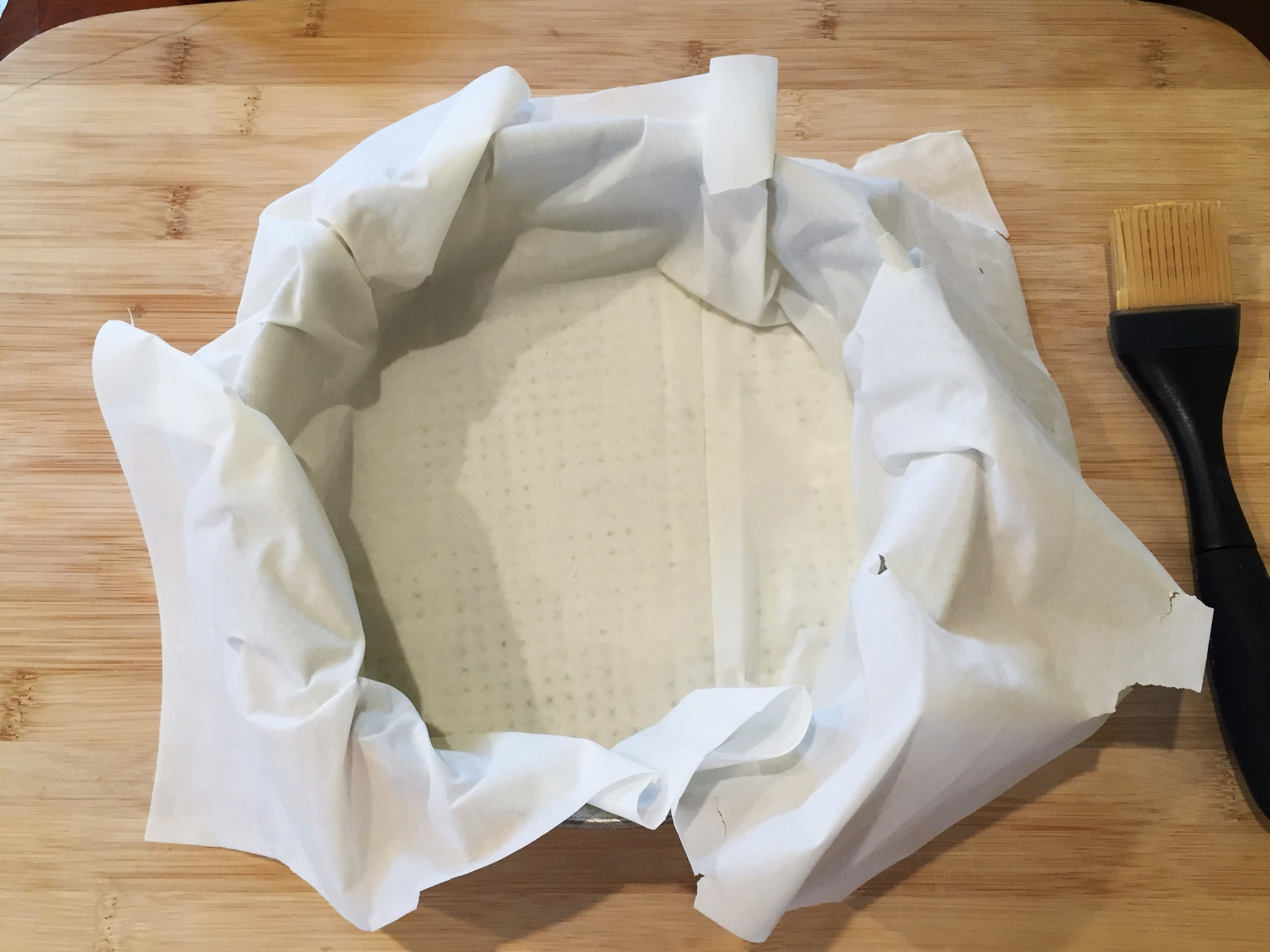 One sheet of phyllo dough lining our springform pan - note that you can see the bottom of the pan through the dough.