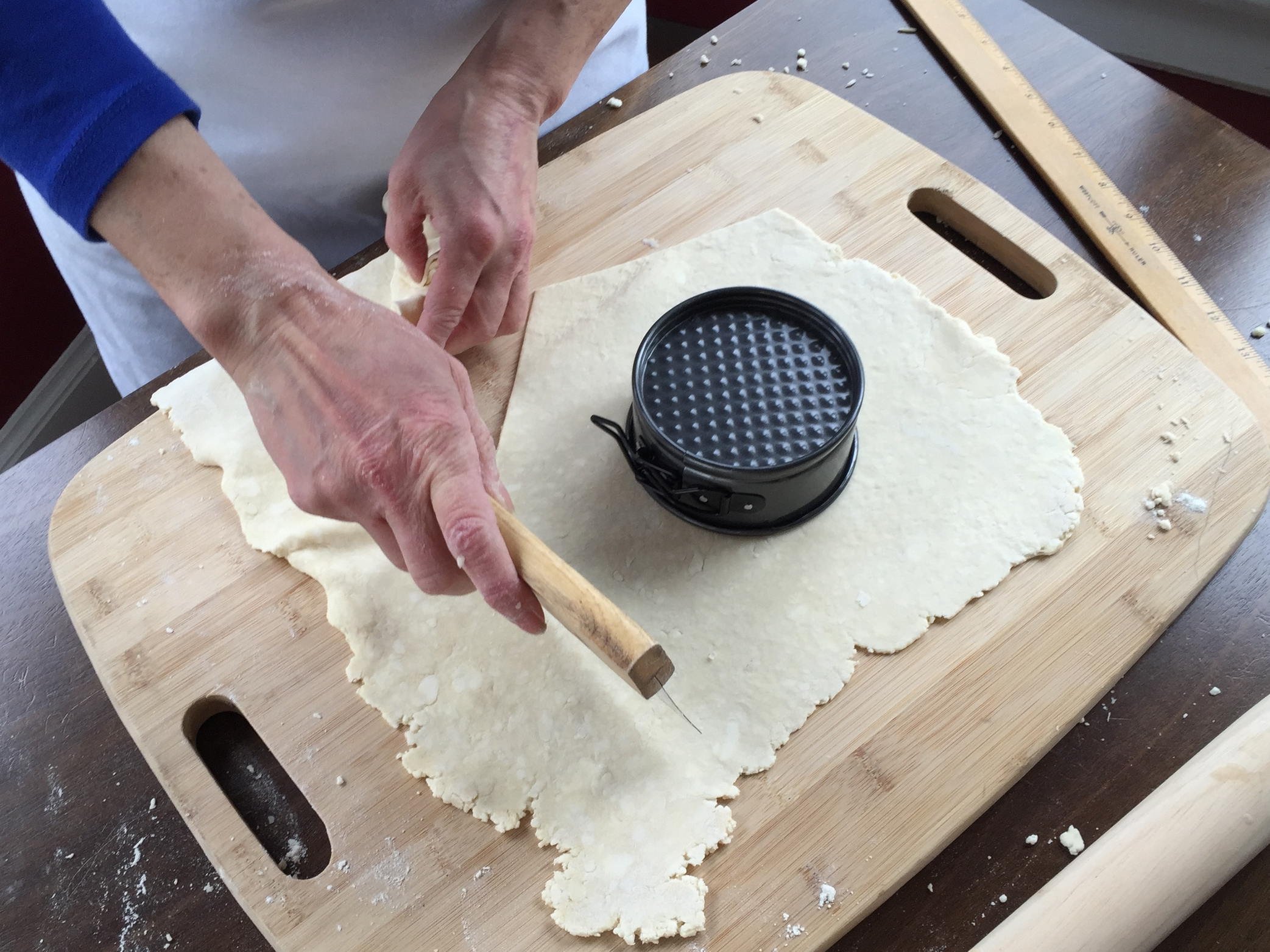 Cutting the pate brisee to fit the springform pan