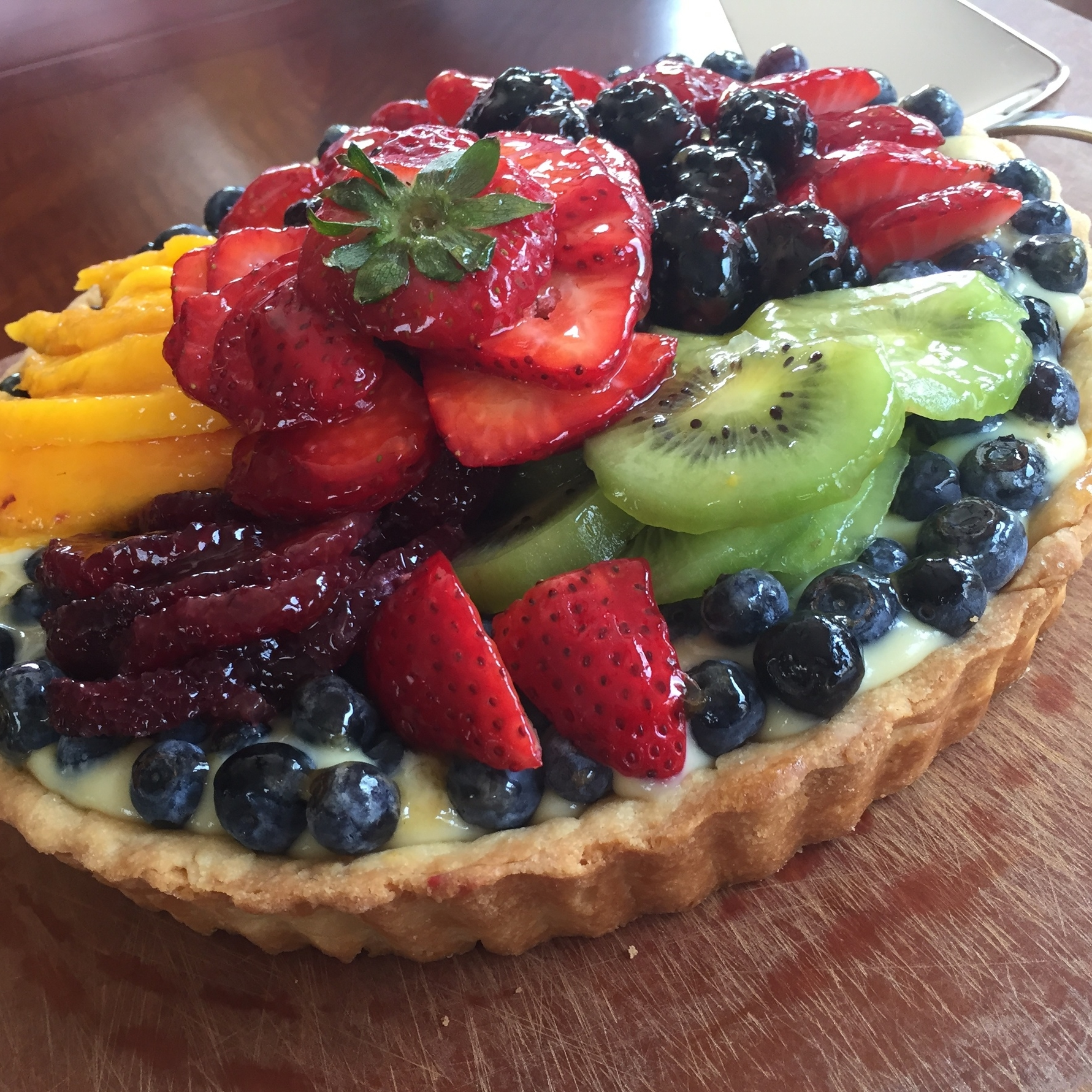 Classic French Fresh Fruit Tart  - made with a classic shortcrust pastry shell, French vanilla cream and fresh fruits, brushed with an apricot glaze.