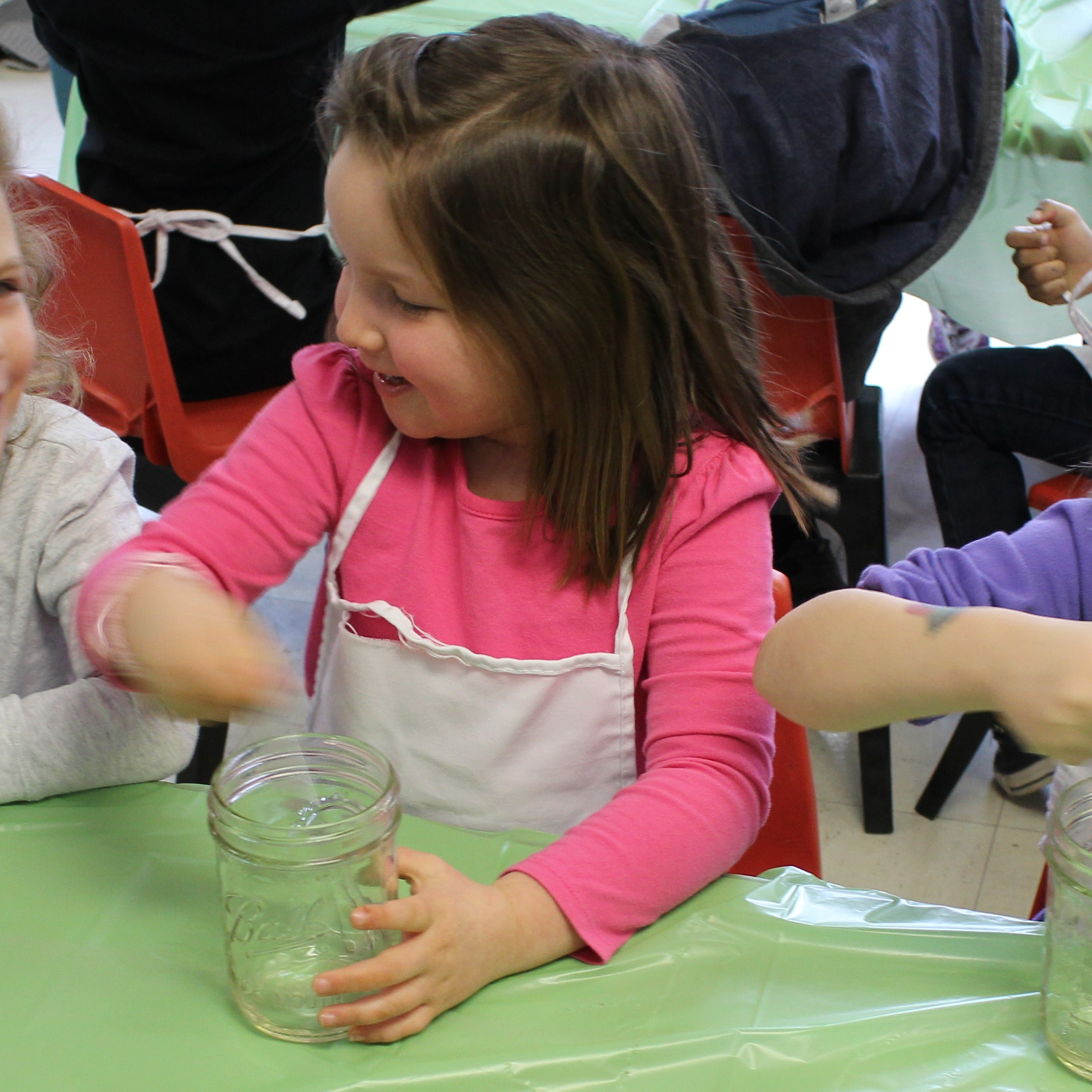 The kids enjoyed using their wire whisks and Ball jars to make music, prior to using them to mix bread pudding ingredients.