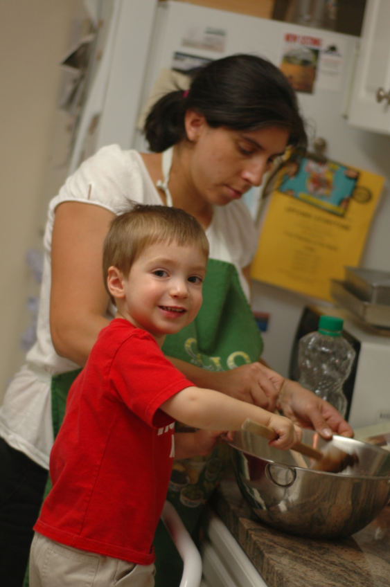 A much younger Nicholas helping his mom Katie make brownies.