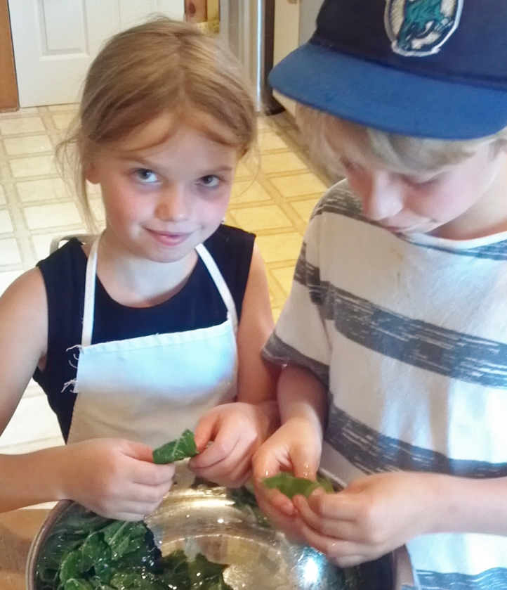 My kids helping to make kale chips a couple years ago.
