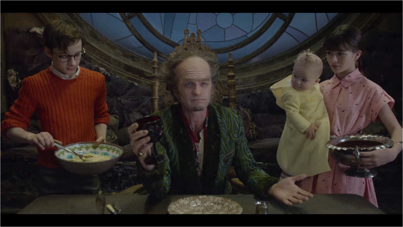 This still image was obtained by questionable means from the  Netflix  corporation. It contains clear evidence of the delicious meal of Pasta Puttanesca prepared by the Baudelaires, as well as the terrible table manners of Count Olaf, seen here preferring roast beef.
