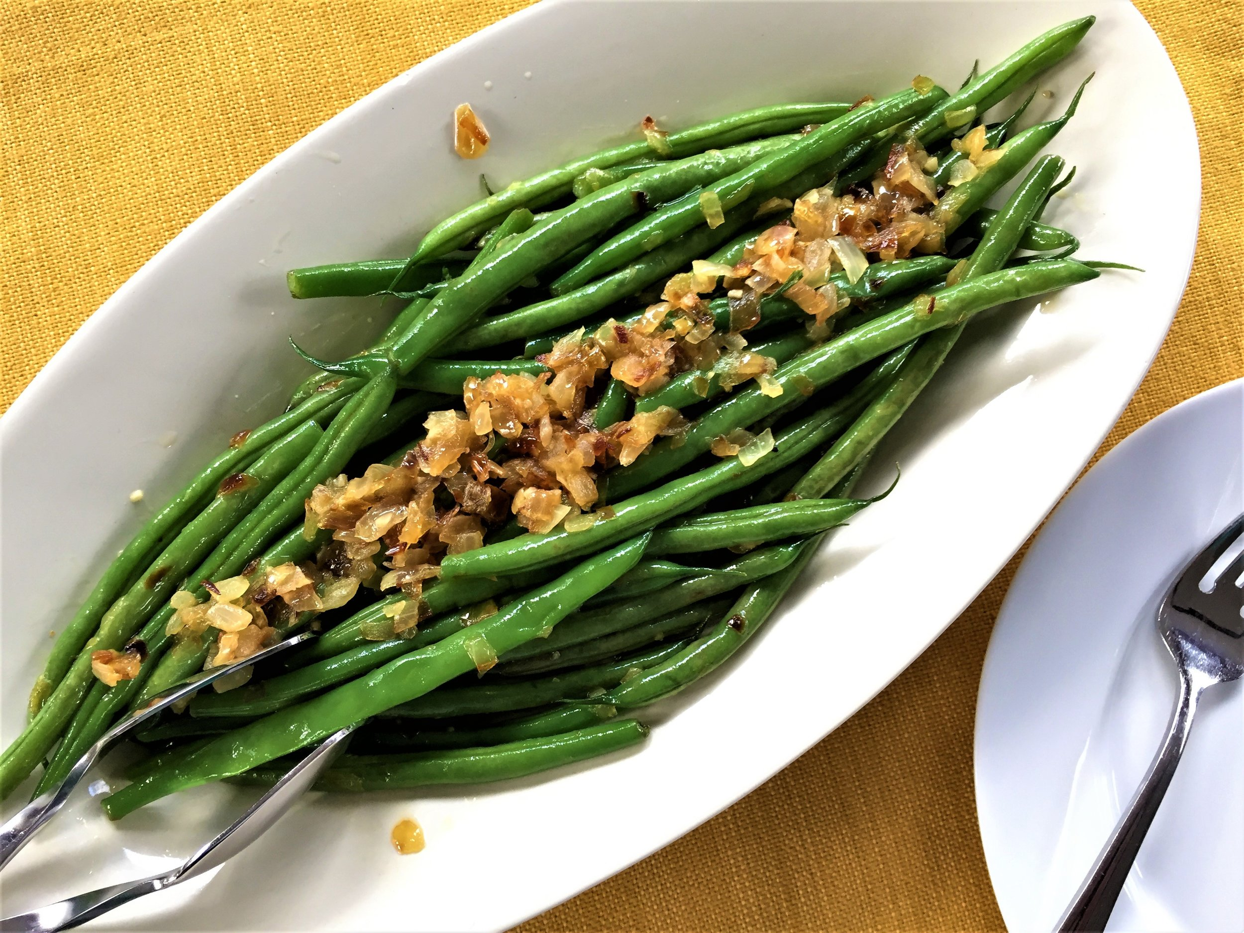 Buttery Green Beans with Garlic and Onions, made in the Adventure Kitchen.