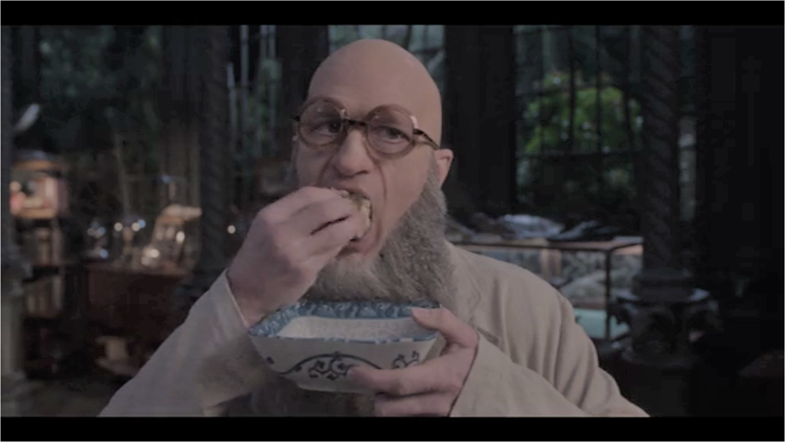 This image, obtained by one of my associates from the Netflix corporation, shows Count Olaf disguised as Stephano, villainously shoving all of the potstickers into his own vile mouth.