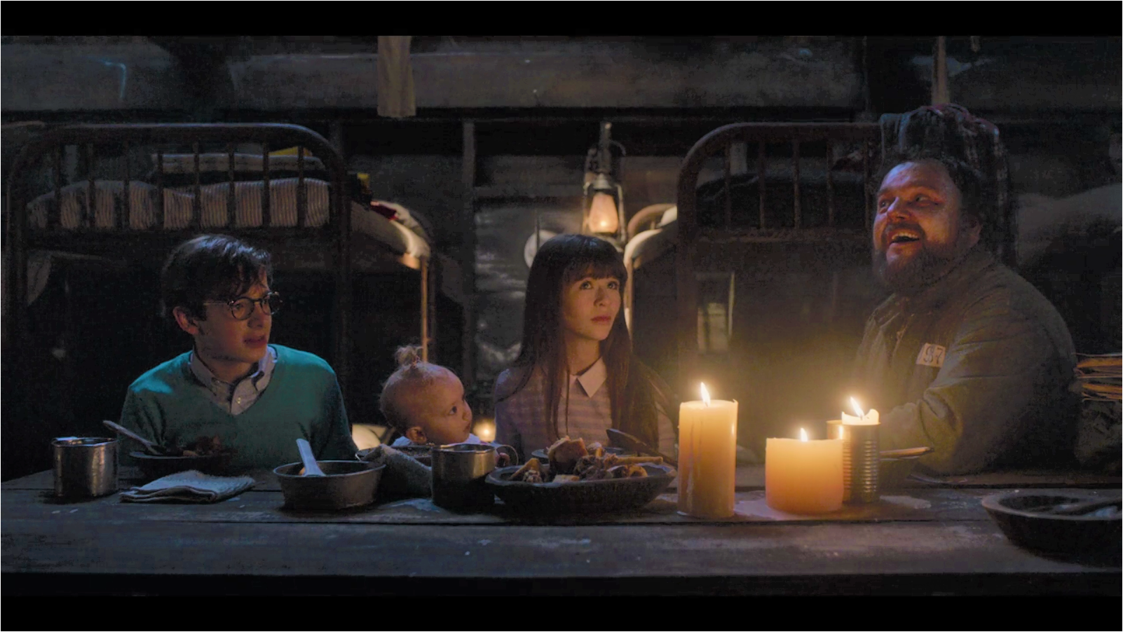 The Baudelaire orphans eating a terrible beef casserole in a dimly-lit room with an optimist and lots of coupons. (Obtained by questionable means from the Netflix corporation.)