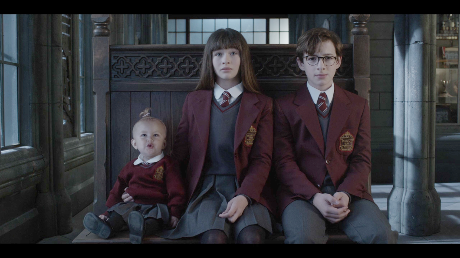 Violet, Klaus and Sunny Baudelaire, during their time at boarding school. This photograph was most likely taken by a Netflix henchperson.