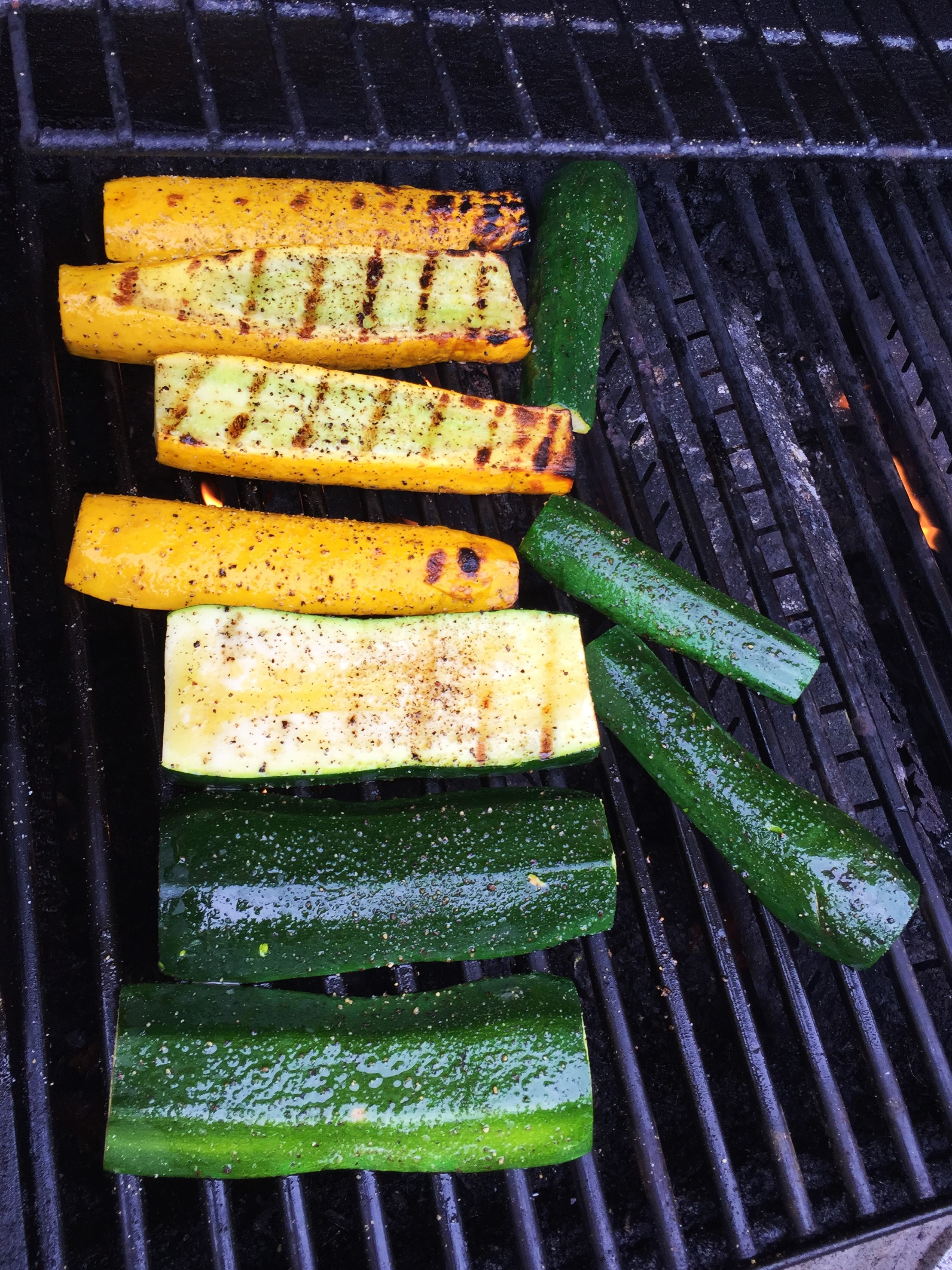 Zucchini cut into planks, on the high heat side of the grill. They'll get flipped over again for a little more char before they're done.